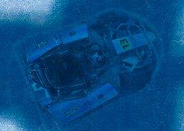 Detail van vloer in barpitt bij Icekartbaan Skidôme Rucphen, Icekart onder ijs. Berebeeld beeldmanipulatie voor Metro XL.